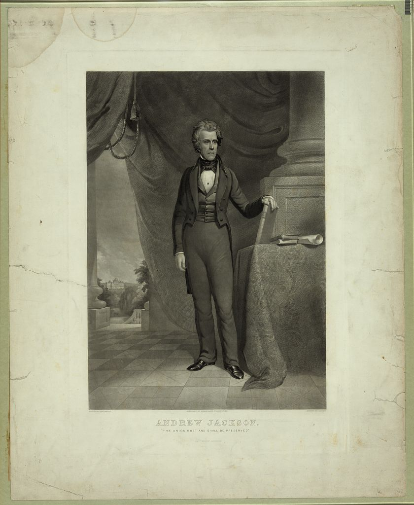print style of President Andrew Jackson in a suit, he is depicted in an open area in front of a large column with curtains. The depiction is a romanticized backdrop and Jackson leans to his left with his left hand placed firmly on a book that rest on a table.